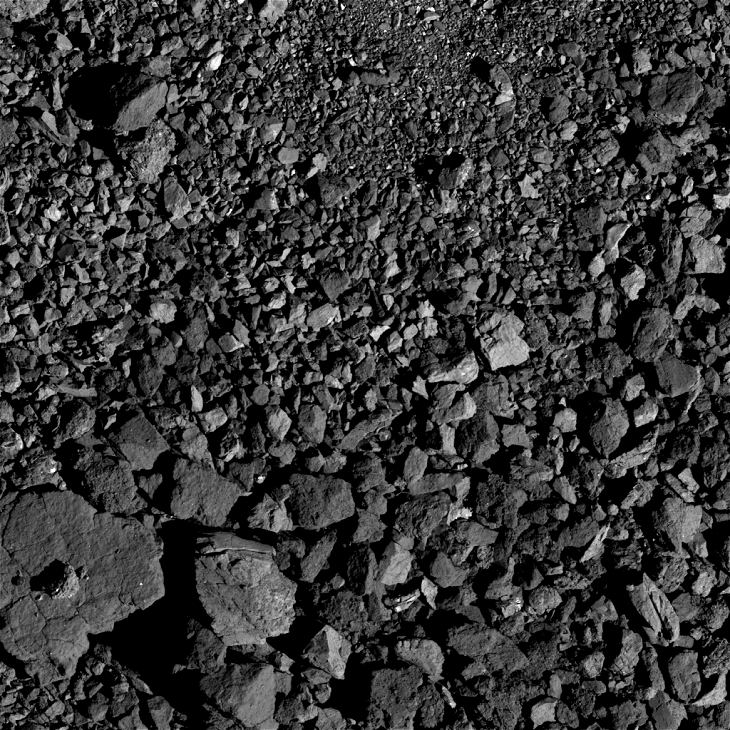 Bennu Asteroid: Large triangular object with small feature in its center - Click for original image at 1:1 scale