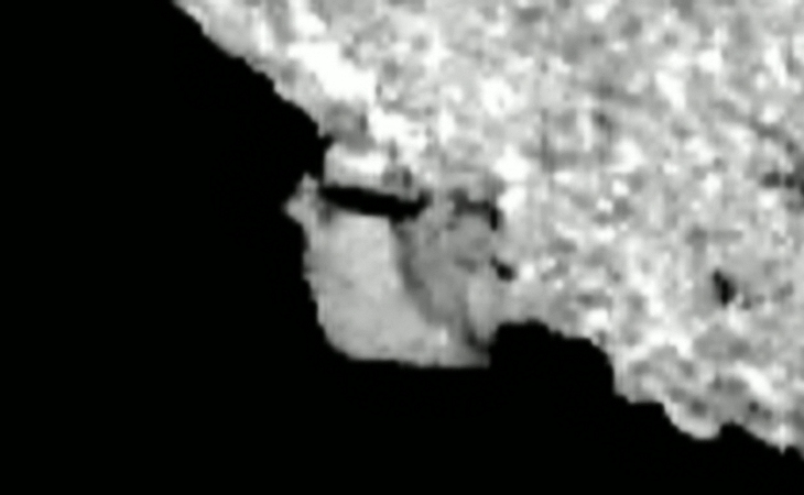Side view of dolmen-type structure on Bennu (click to view larger image)