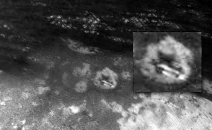 Two cigar shaped craft in Martian crater