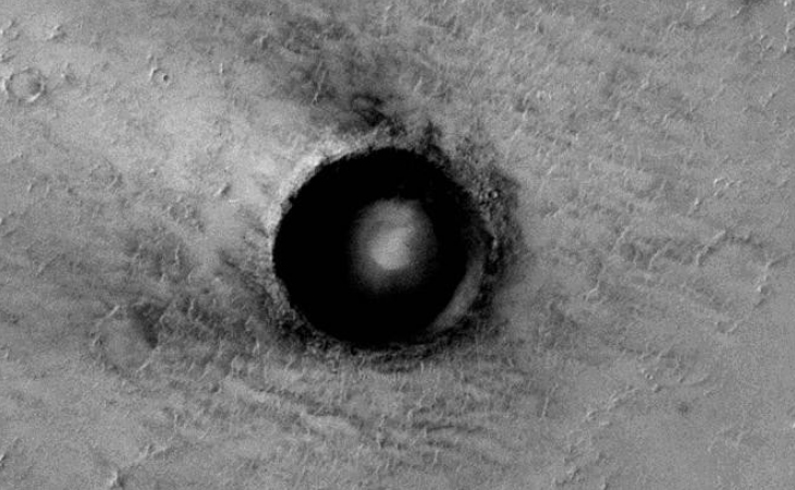 Self-illuminating sphere inside Martian crater
