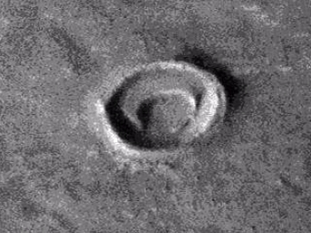 Crescent shaped object inside crater on Mars