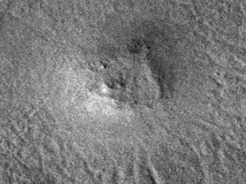 Large buried triangular object on Martian surface