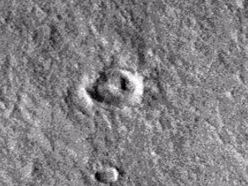 Small triangular object inside cater on Mars