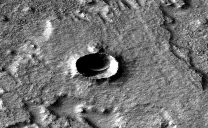 Disc-like craft inside Martian crater