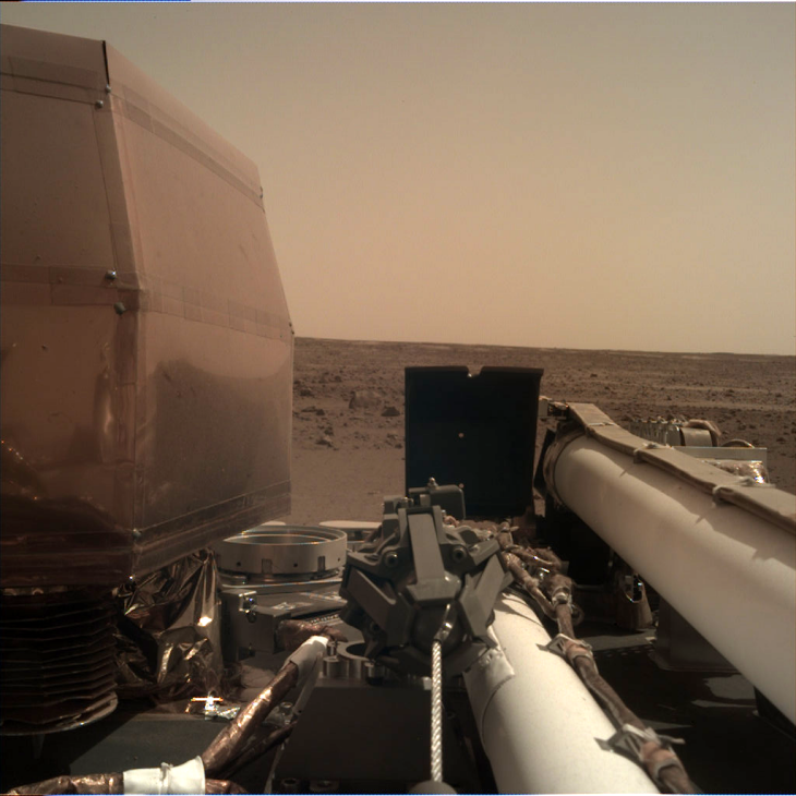 Sol 1: Instrument Deployment Camera (IDC), note the blue sky just vanished