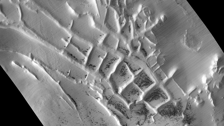 Ancient ruins, retaining walls or possible farming activity on Mars (D04_028911_0985_XN_81S064W)