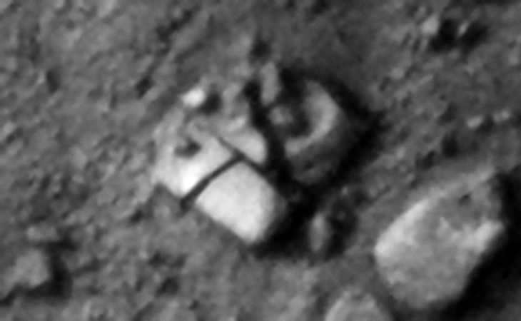 Megalithic blocks and perhaps layered metal plates located to the left