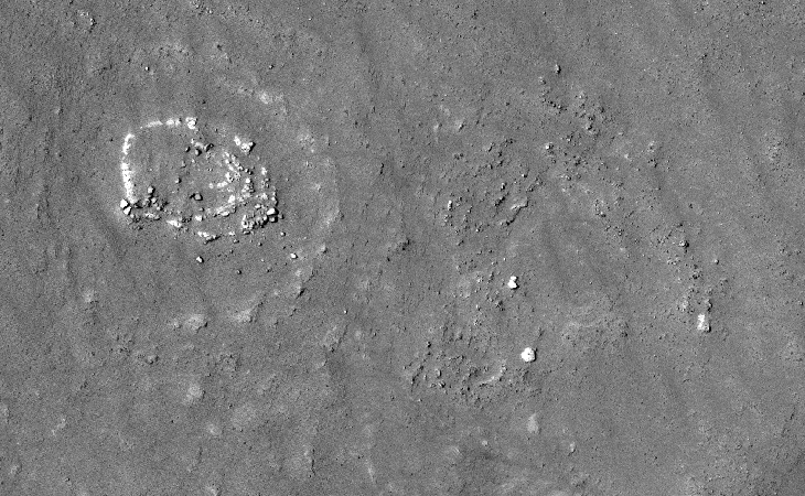 A zoomed-out view of a circular megalithic structure consisting of concentric rings similar to other structures found in Kotka crater