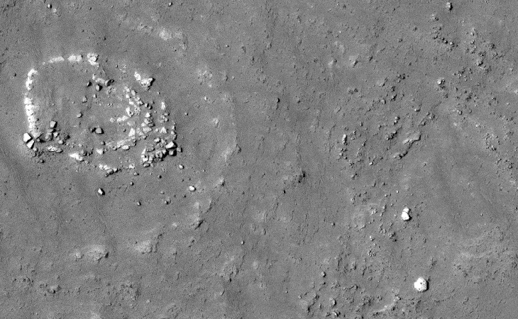 A zoomed-out view of a huge megalithic block near the circular structure