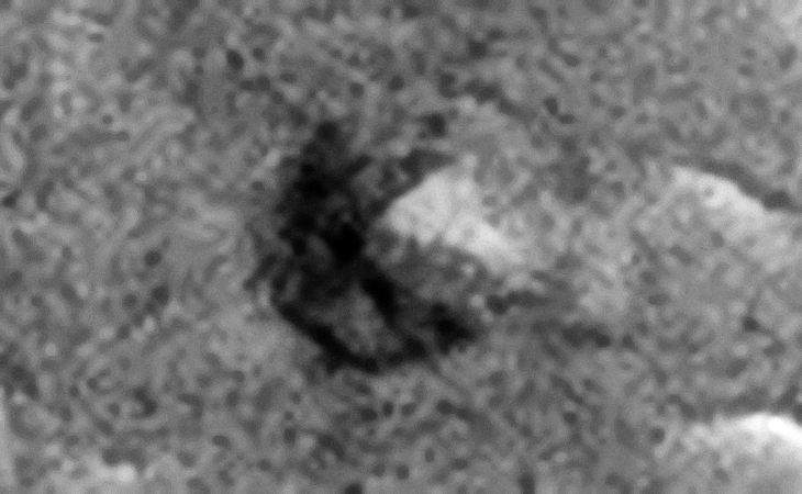 Another triangular area inside a crater/pit on Mars that appears to be machined leading to perhaps another underground entrance-way?