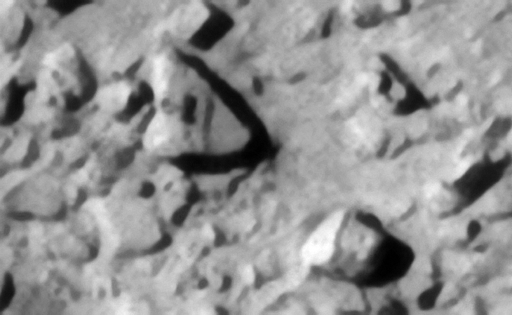 Note the strange Egyptian Ankh-like symbol on the triangular block located to the top left. The square cube-like block to the bottom right has what appears to be a larger base on the side. A perfect spherical feature is seen on the object located to the middle left