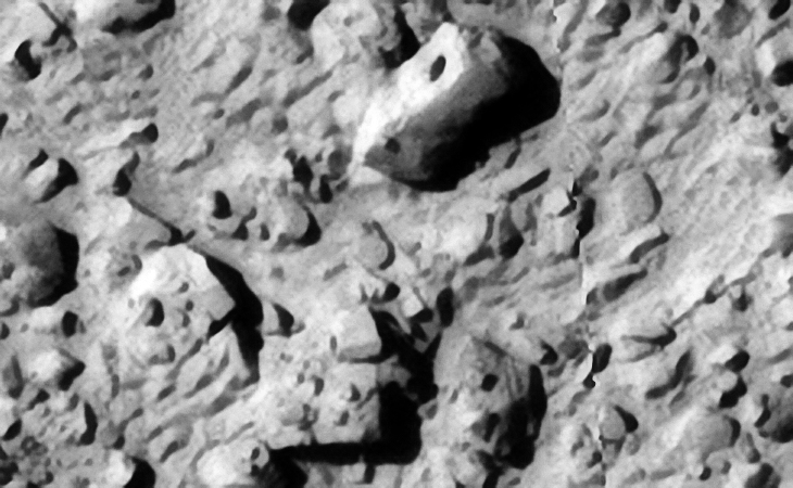 Similar artifact found on Mars: ESP_013805_1295 (click to view larger image at actual 1:1 scale)