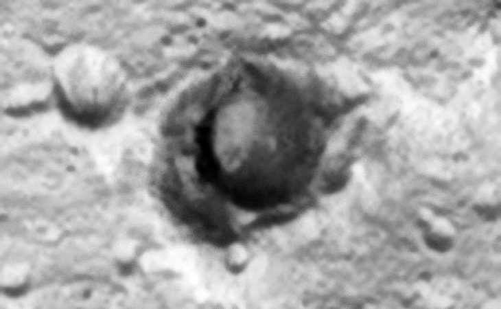 Hangar/Underground Entrance or Crater? The lower rim of the crater appears to be dug out
