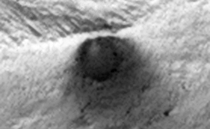 Underground Entrance, Cave, Air-Vent? It appears as if something is being vented which is leaving a dark-coloured stain on the Martian surface