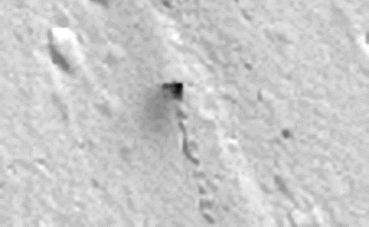 Boulder or Vehicle? The track starts and runs over a flat-plain, a boulder or rock cannot role naturally over a flat plain. The object also appears to be leaving a dark coloured stain on the Martian surface or is that smoke?