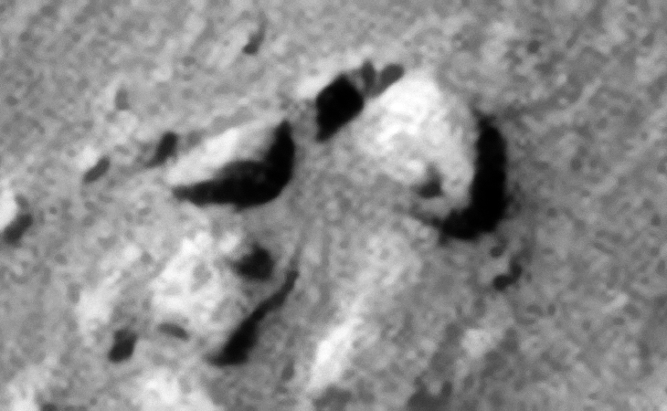 Two eroded blocks with spherical-shaped features or knobs. Note the rectangular block located middle top