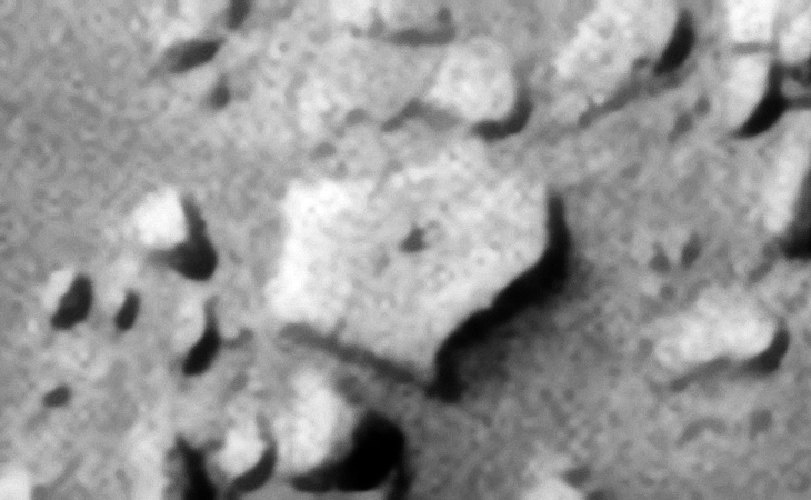 Another hexagonal-shaped object, could this be a metal plate or megalithic slab? There is also a small dome-shaped feature in the center