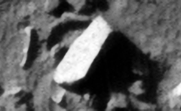 Long, narrow rectangular megalithic block or metal plate/sheet?