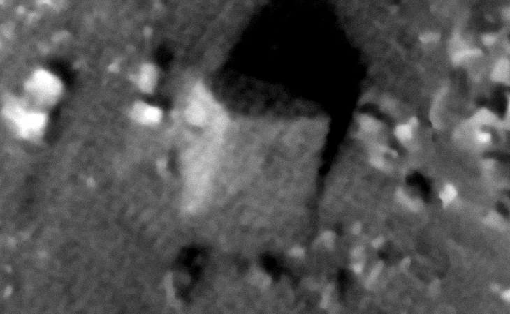 Partially buried, large megalithic-block on Mars (approximately 8 metres wide)
