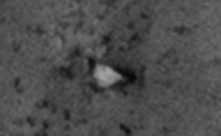 Wedge-shaped craft embedded in Martian surface?
