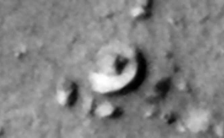 Saucer-shaped craft sitting on the Martian surface