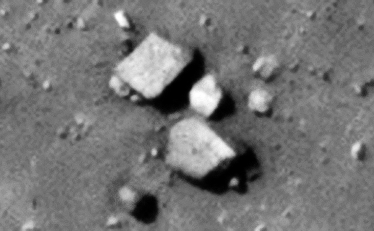 Two megalithic blocks and a small cube-shaped piece with possibly small dome on top